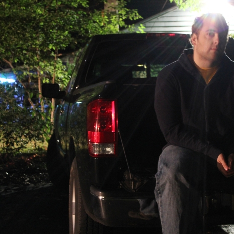 Alex Rybacki sits on a truck bed posing for a night shot on September 15.